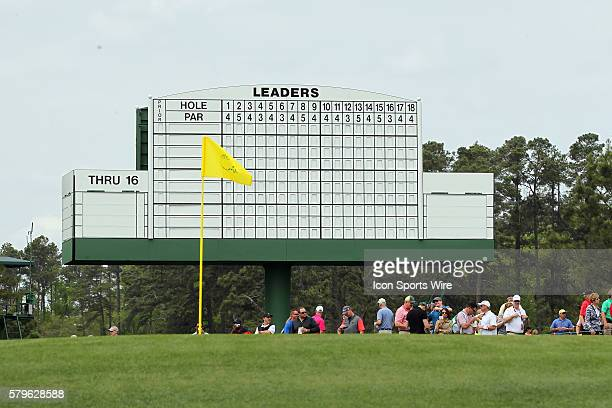 A view of the pin flag on the 17th green with the leaderboard standing tall in the background during the practice round for the 2015 Masters...