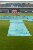 View of the pitch covered due to a rainfall during the Twenty20 international match between South Africa and Australia at Axcess park St Georges on...