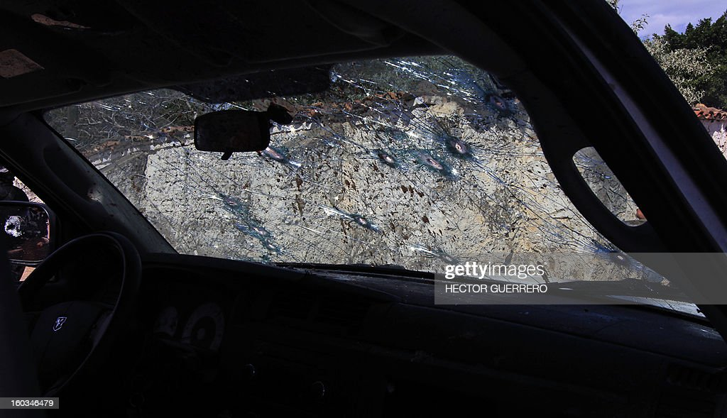 View of the police van attacked by gunmen in Hostotipaquillo, Jalisco State, Mexico on January 29, 2013. An unidentified armed command killed three people, including the police director of the municipality Hostotipaquillo, Lucio Rosales Astorga. AFP PHOTO/Hector Guerrero