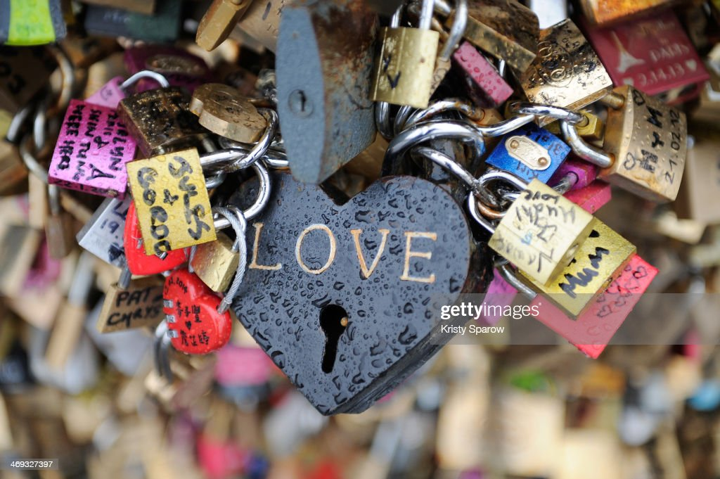 A view of the Pont Des Arts on Valentine's Day on February 14, 2014 in Paris, France. The accumulation of the 'love locks', a phenomenon popular in many European cities, where couples attach a lock to symbolise their love to the mesh panels on the sides of the bridge, is starting to pose safety concerns, due to their mass weight.