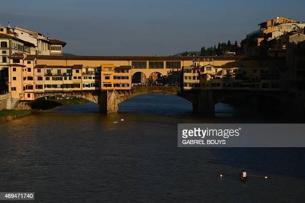 View of the Ponte Vecchio over the Arno River taken on April 8 2015 AFP PHOTO / GABRIEL BOUYS