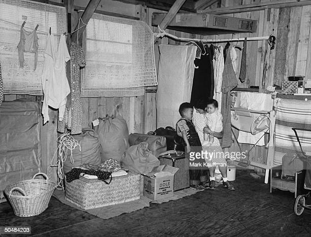A view of the prisoners sitting in their living spaces in the Japanese occupation camps in Santa Anita