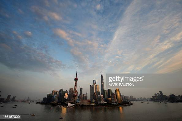 View of the Pudong financial district skyline from the historic Bund in Shanghai on October 29 2013 China's ruling Communist Party will hold a key...