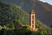 View of the Pyrenees Mountains and the red brick tower