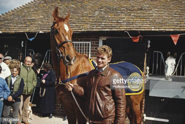 View of the race horse Mr Frisk being held by amateur jockey Marcus Armytage at trainer Kim Bailey's yard at Andoversford near Cheltenham...