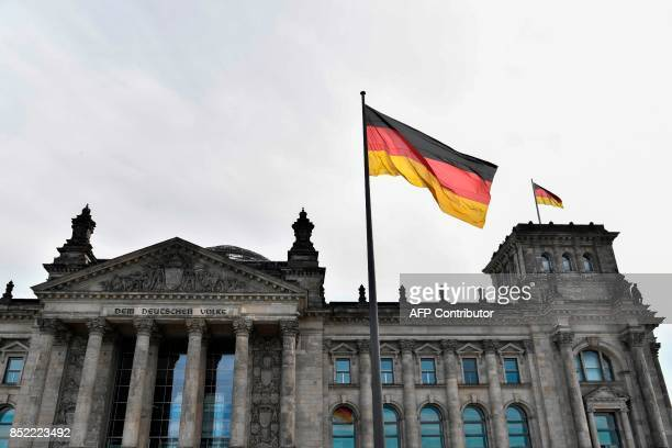 View of the Reichstag building which houses the Bundestag Lower House of parliament in Berlin taken on September 23 2017 Germany goes to the polls...