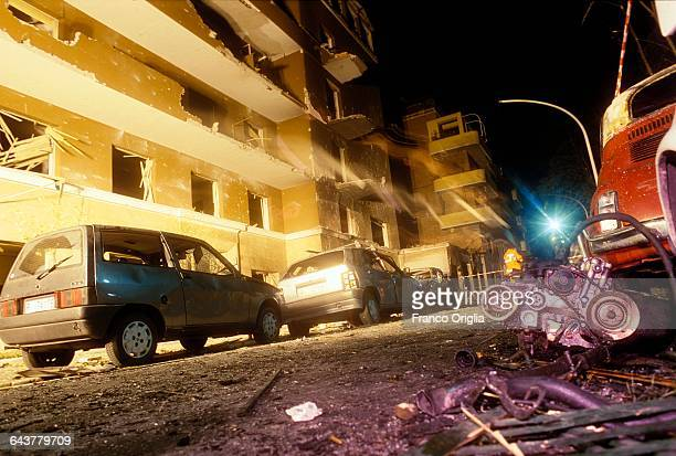 A view of the remains of cars in Via D'Amelio after the mafia bombing that killed Italian antimafia judge Paolo Borsellino and five members of his...