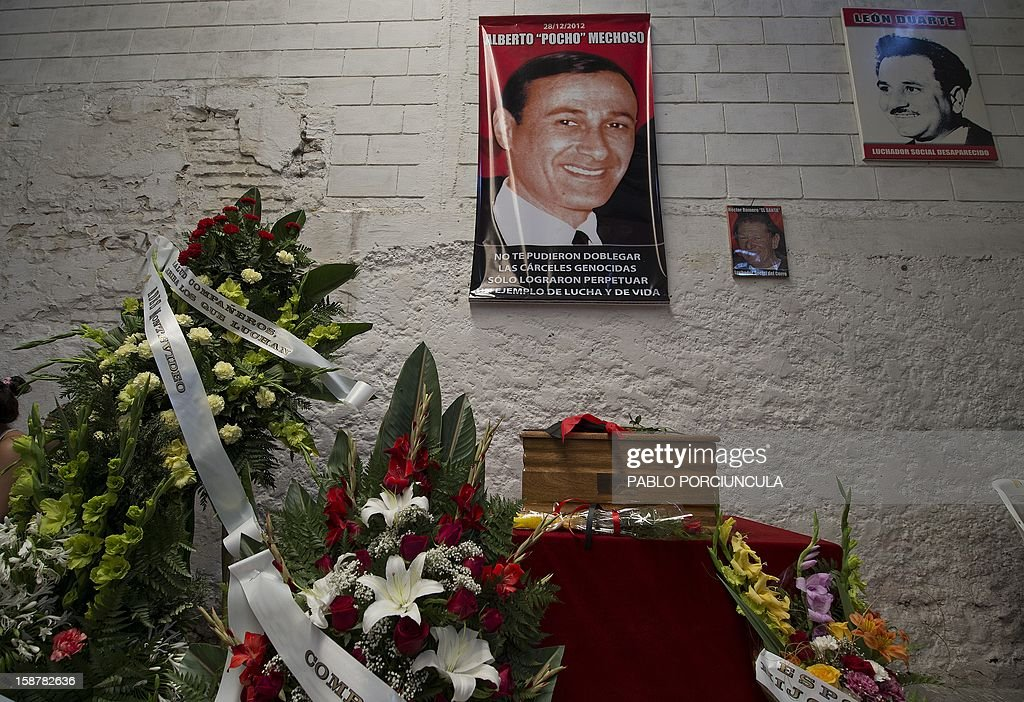 View of the remains of Uruguayan anarchist Alberto Mechoso during his wake on December 28, 2012 in Montevideo. The Uruguayan government gave the remains of Mechoso to his relatives after being identified in Argentina. Mechoso was detained in September 26, 1976 and he was seen for the last time at the clandestine detention centre Automotoras Orletti on that year. AFP PHOTO/Pablo PORCIUNCULA