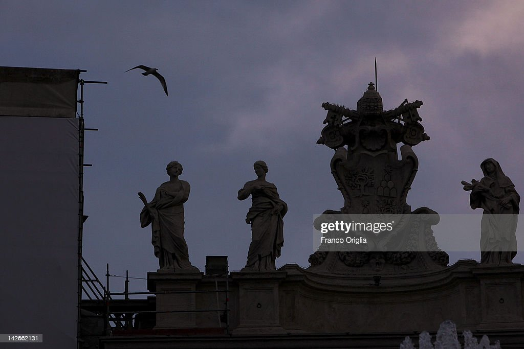 A view of the restoration works of the colonnade of Gian Lorenzo Bernini in St. Peter's Square on April 10, 2012 in Vatican City, Vatican. The square was designed by architect Gian Lorenzo Bernini in 1656. The two semi-circles of the colonnade are surrounded by 140 statues and 244 columns. Guy Devreux of the Vatican Laboratory for Marble and Cast began direction of the works in 2009. A low-voltage electric net is now mounted around the perimeter to protect the colonade from the birds nesting within the roof.