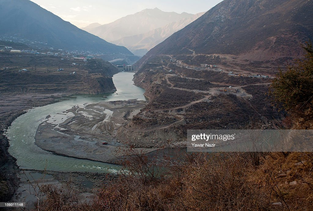 A view of the river Jehlum that flows from Indian-administered Kashmir to Pakistan near the border area near Uri on January 11, 2013 in Salamabad, 120 km (75 miles) northwest of Srinagar, the summer capital of Indian Administered Kashshmir, India. People living in the mountainous region along the Line of Control (LOC), a military line that divides Indian-administered Kashmir from the Pakistan-administered Kashmir have continually been at risk due to hostility between the armies of the two rival nations, but trade has been carried out smoothly across the Line of Control in North Kashmir. Two Indian and two Pakistani soldiers have been killed in the last week near the Line of Control dividing Kashmir, with both countries blaming each other for the escalating tension.
