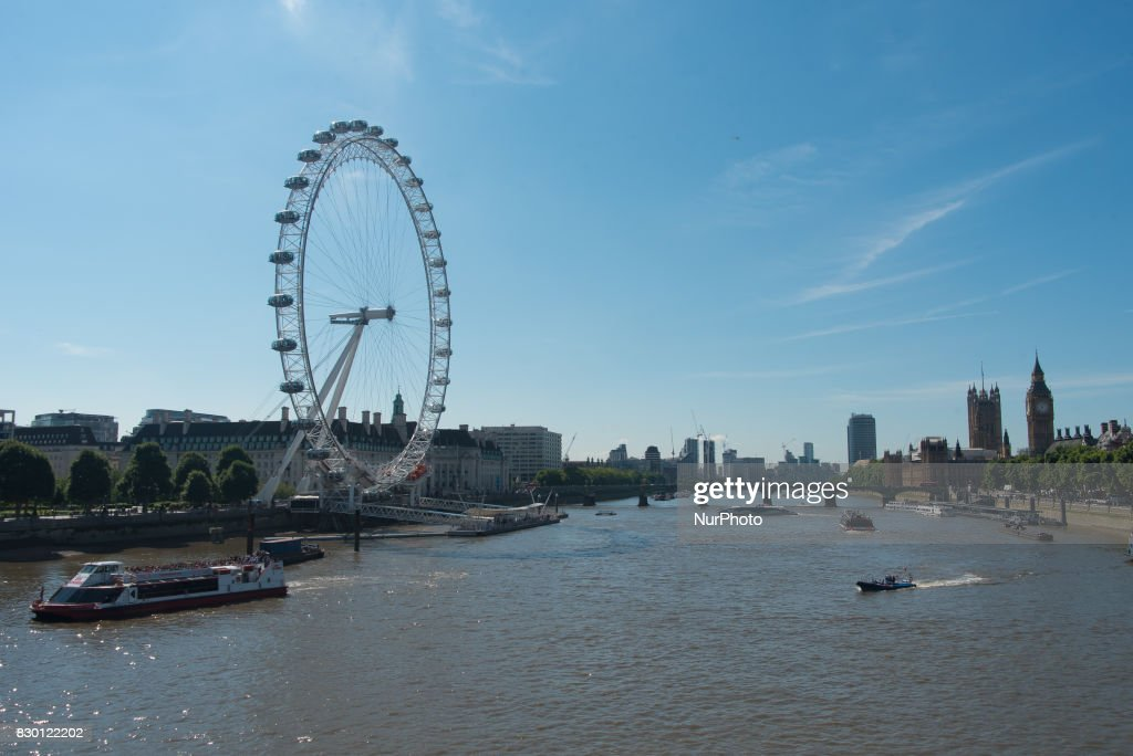 View of the river Thames with London Eye and the Houses of Parliament in a sunny morning in London, on August 11, 2017. The South Bank is an entertainment and commercial district of central London, next to the River Thames opposite the City of Westminster. It forms a narrow, unequal strip of riverside land within the London Borough of Lambeth and the London Borough of Southwark where it joins Bankside. As with most central London districts its edges evolve and are informally defined however its central area is bounded by Westminster Bridge and Blackfriars Bridge. It includes points of interest such as the iconic London Eye, Southbank Centre, National Theatre and Tate Modern.