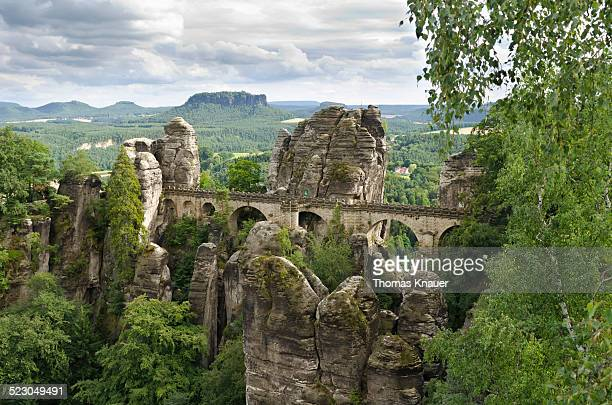 View of the rocks of the Bastei and the Basteibruecke bridge, behind Mt. Lilienstein, Elbe Sandstone Mountains, Saxony, Germany, Europe