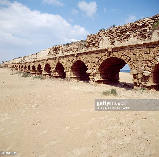 View of the Roman aqueduct on the beach in Caesarea Israel