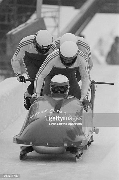 View of the Romania 1 fourman bobsleigh team of Dorin Degan Cornel Popescu Gheorghe Lixandru and Costel Petrariu in action at the start of...