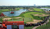 A view of the Rory McIlroy Rickie Fowler and Matteo Manassero match on the 9th green with large galleries watching during the second round of the Abu...