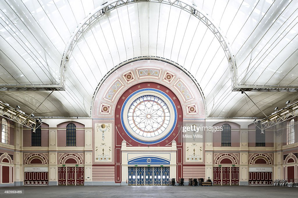 A view of the Rose Window and Great Hall at Alexandra Palace on May 16, 2014 in London, England. Alexandra Palace situated in the London Borough of Haringey First opened as 'The People's Palace' in 1873. Just 16 days later a fire broke out in the Palace, burning it down in its entirety. On 2 November the world's first regular high-definition public television broadcast took place from the BBC studios at Alexandra Palace. In 1980 fire again burned a large part of the building, the Palace reopened in 1988. Recently awarded a Round 1 pass from The Heritage Lottery Fund the Palace plans to renovate parts of the derelict building including the BBC Studios and Victorian Theatre.
