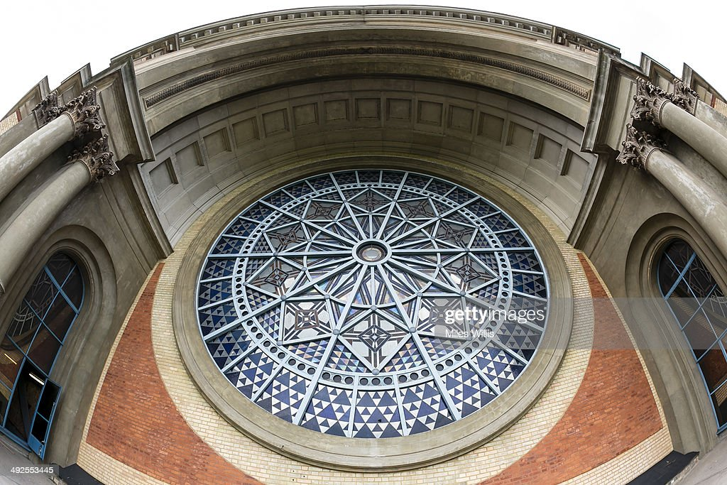 A view of the Rose Window at Alexandra Palace on May 16, 2014 in London, England. Alexandra Palace situated in the London Borough of Haringey First opened as 'The PeopleÕs Palace' in 1873. Just 16 days later a fire broke out in the Palace, burning it down in its entirety. On 2 November the world's first regular high-definition public television broadcast took place from the BBC studios at Alexandra Palace. In 1980 fire again burned a large part of the building, the Palace reopened in 1988. Recently awarded a Round 1 pass from The Heritage Lottery Fund the Palace plans to renovate parts of the derelict building including the BBC Studios and Victorian Theatre.