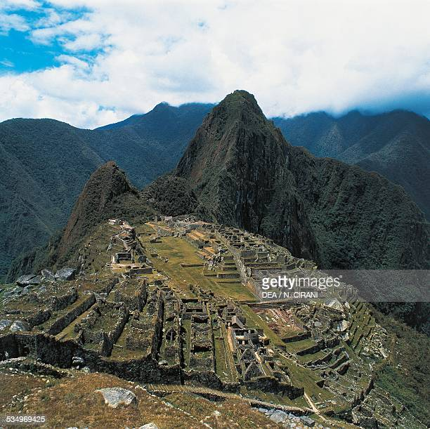 View of the ruins of the Inca city of Machu Picchu 15th century Urubamba Valley Peru