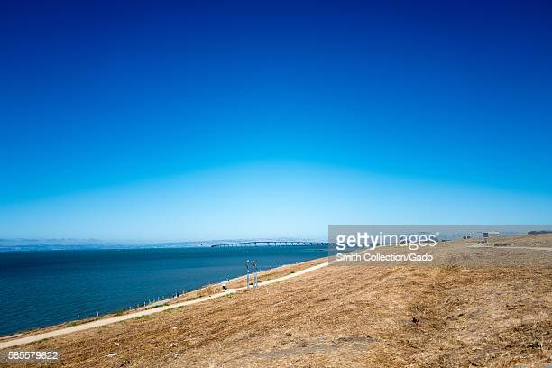 View of the San Mateo Bridge across the San Francisco Bay from a hill in in Seal Point Park San Mateo California July 2016