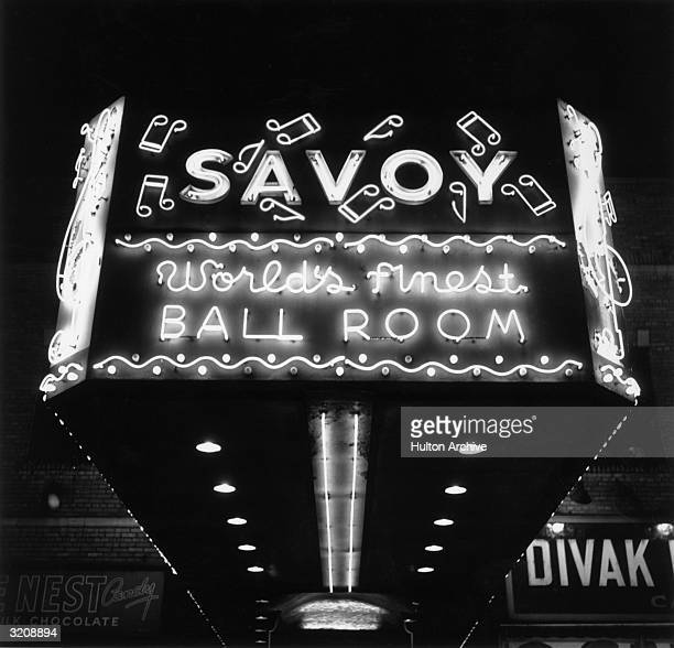 View of the Savoy Ballroom's neon marquee at night in Harlem New York City
