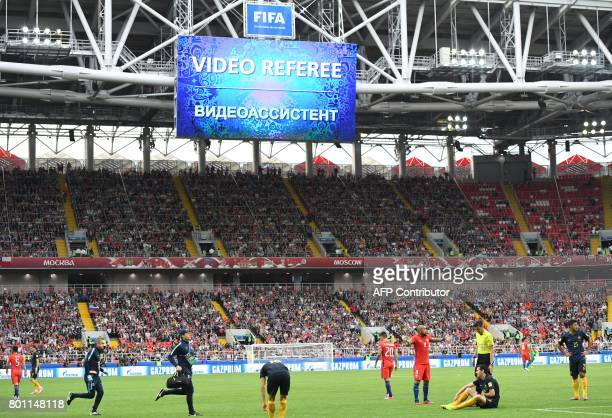 View of the screen as video referee assitance is used as Chile's midfielder Arturo Vidal gestures towards the referee as Australia's forward Tomi...