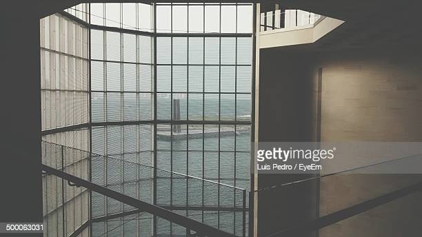 View of the sea through glass block wall