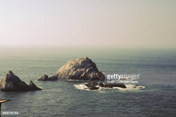 View of the Seal Rocks off the coast viewed from the Cliff House in the Land's End neighborhood of San Francisco California 1978
