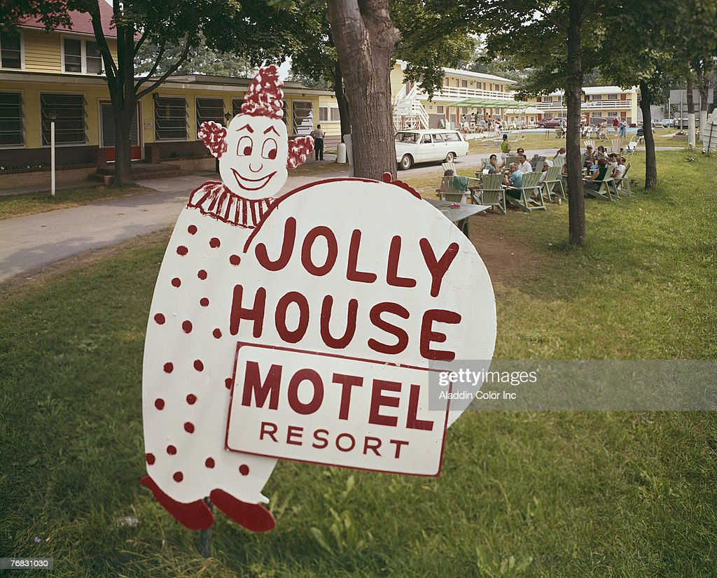 View of the seemingly handpainted sign for the Jolly House Motel Resort which features a clown in the Catskills New York 1960s