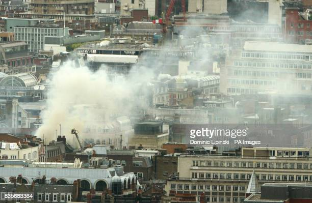 A view of the smoke in Dean Street London from the London Eye where sixty firefighters are tackling a fire in what is believed to be an office block