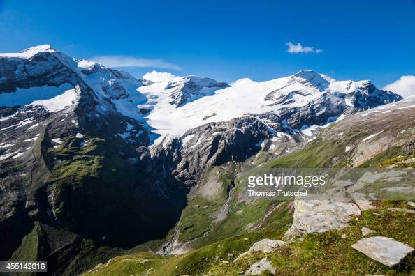 View of the snowcapped massif at the mountain reservoir Mooserboden with the summit of the Baerenkopf and the Karling glacier on August 22 in...