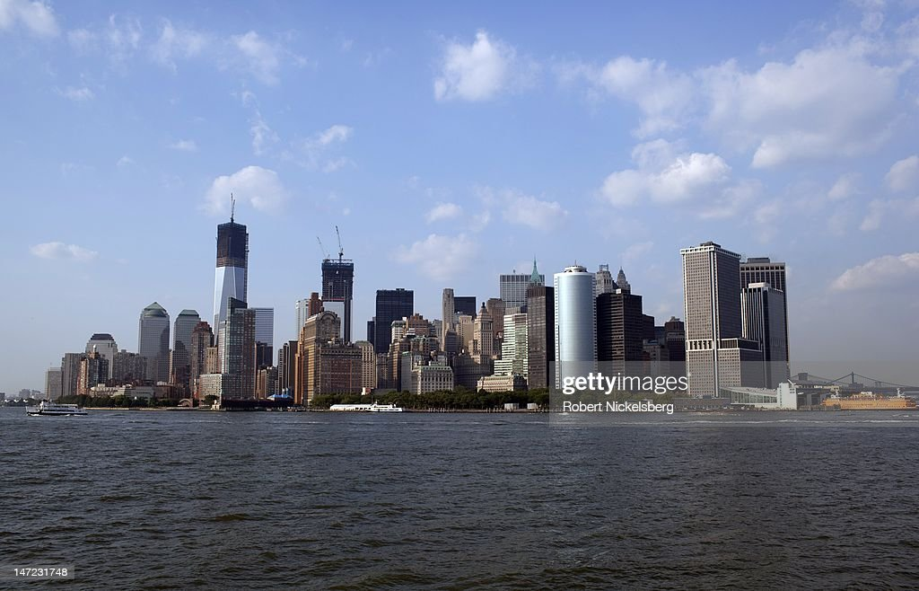 A view of the southern tip of New York City's financial district June 20, 2012 from the Staten Island Ferry in New York City. The new World Trade Tower, center left, is under construction.