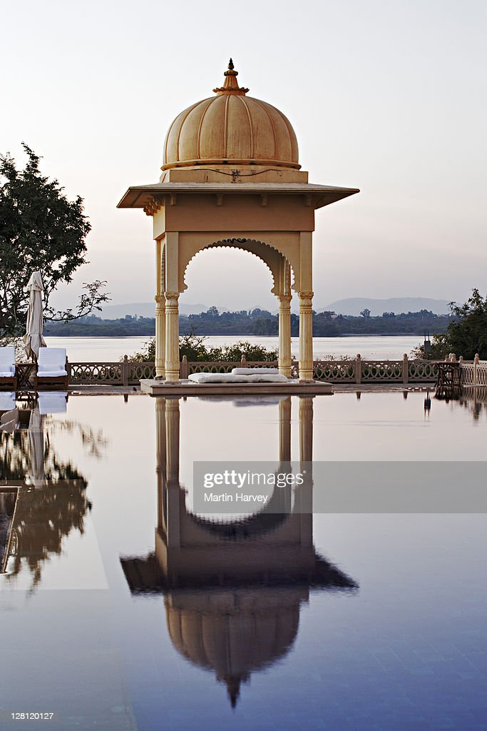 View of the spa pool at Udaivilâs Oberoi Hotel. Lake Pichola in the background. Udaipur. India. This hotel has been voted the 3rd best hotel in the world by Travel and Leisure Magazine. : Stock Photo