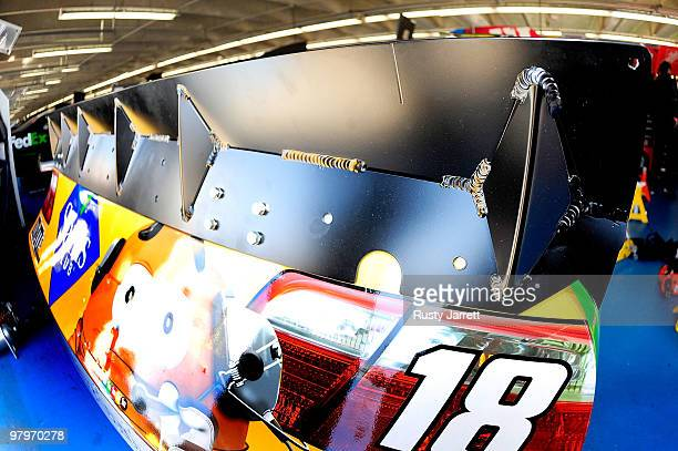 A view of the spoiler on the Joe Gibbs Racing Toyota driven by Kyle Busch in the garage during spoiler testing at Charlotte Motor Speedway on March...