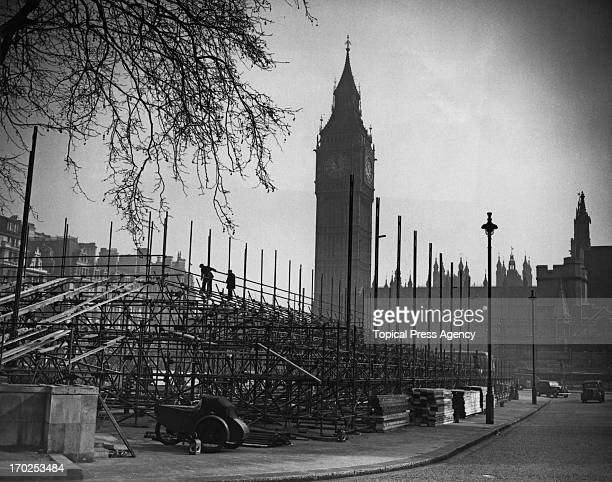 A view of the stands being assembled in Parliament Square in preparation for the Coronation London 17th March 1953 The men are seen working high on...