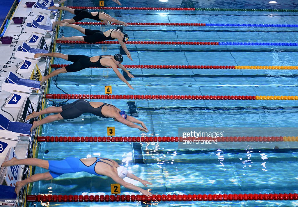 View of the start of the 4th heat of the women's 50m breaststroke at the European Swimming Championships on November 22, 2012, in Chartres. AFP PHOTO ERIC FEFERBERG