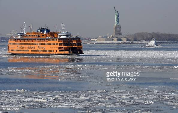 A view of the Statue of Liberty is seen as the Staten Island Ferry passes by on February 25 2015 as the New York Harbor is filled with large chunks...