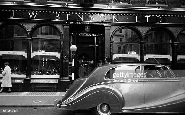 View of the storefront for the watchmaker JW Benson Ltd on Old Bond Street in London United Kingdom 1952 A chauffeur can be seen waiting outside...