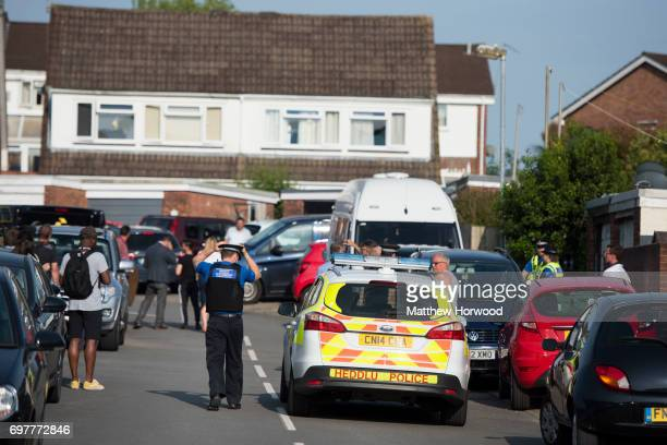 A view of the street during a search of a house on Glyn Rhosyn Pentwyn which is believed to be the home of Darren Osborne who has been named as the...