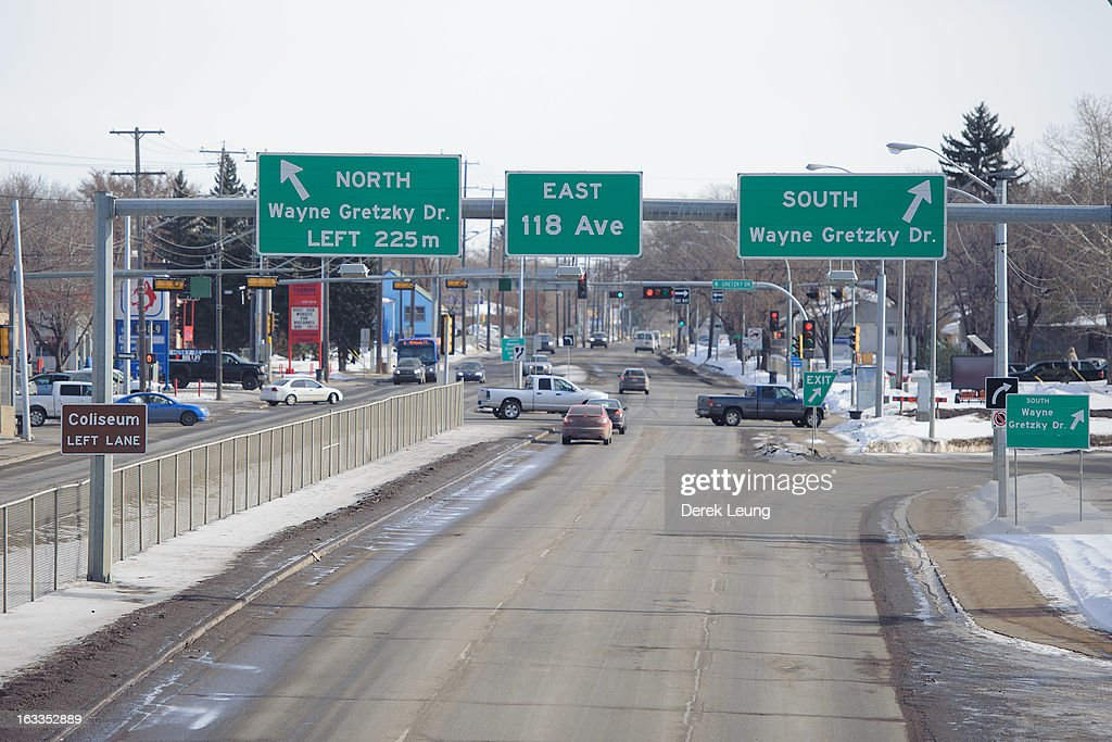 A view of the street signs in front of Rexall Place directing traffic to North and South Wayne Gretzky Drive seen before an NHL game between the Edmonton Oilers and the Phoenix Coyotes at Rexall Place on February 23, 2013 in Edmonton, Alberta, Canada.