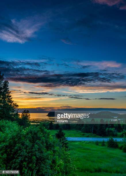 A view of the sun setting on Le Bic and its National park, in Bas Saint-Laurent (Lower Saint Lawrence) region, Québec.