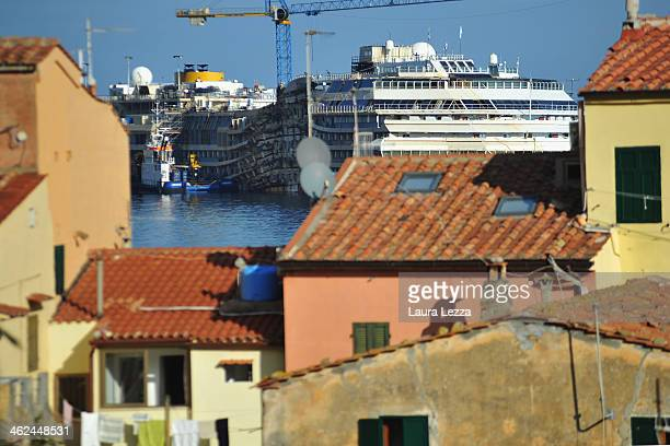 A view of the sunken ship Costa Concordia is seen the day of commemoration on January 13 2014 in Giglio Porto Italy Two years after the sinking of...