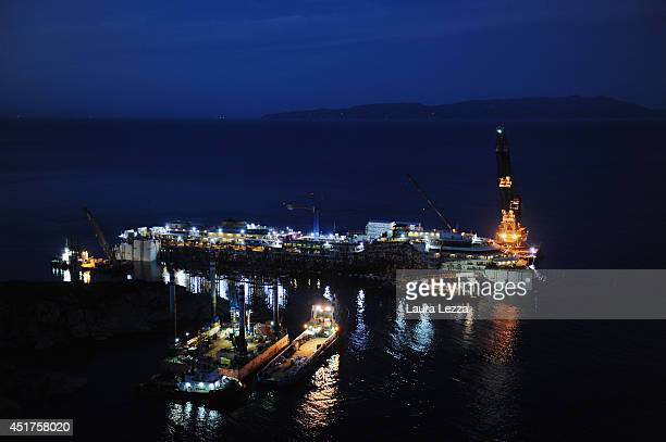 A view of the sunken ship Costa Concordia is seen the night before the last sponson is installed on the port side of the wrecked ship Costa Concordia...