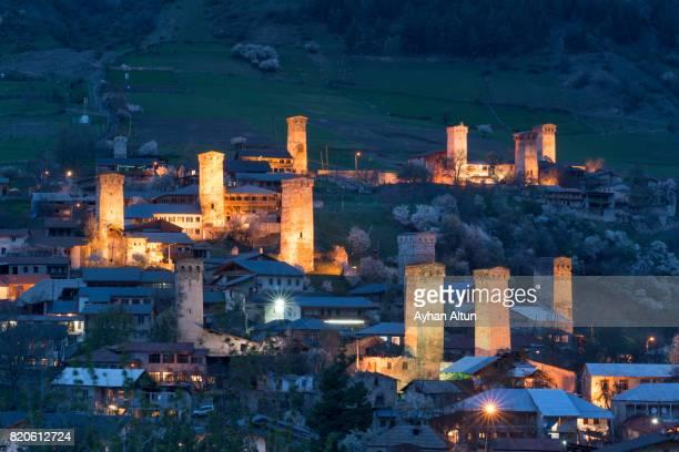 View of the Svanetian towers with night illumination in Mestia Town, Upper Svaneti, Georgia