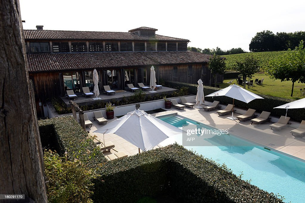 A view of the swimming pool and solarium at the 'Caudalie Sources' hotel ('Les sources de Caudalie'), in Martillac, southwestern France, on September 2, 2013, near the wine-producing Smith Haut Laffite castle. The Smith Haut Laffite castle's wine is condidered as a 'grand cru de Graves' and the 'Les sources de Caudalie' hotel specializes in wine and grape related spa treatments.