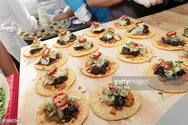 A view of the Taco Bamba Taqueria booth at the CocaCola Backyard BBQ hosted by Bobby Flay and Michael Symon presented by Thrillist sponsored by...