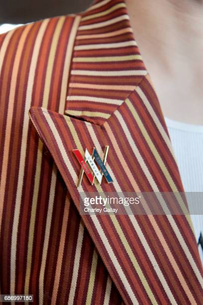 A view of the Teen Cancer America pins at the Wolk Morais Collection 5 Fashion Show at Yamashiro on May 22 2017 in Los Angeles California