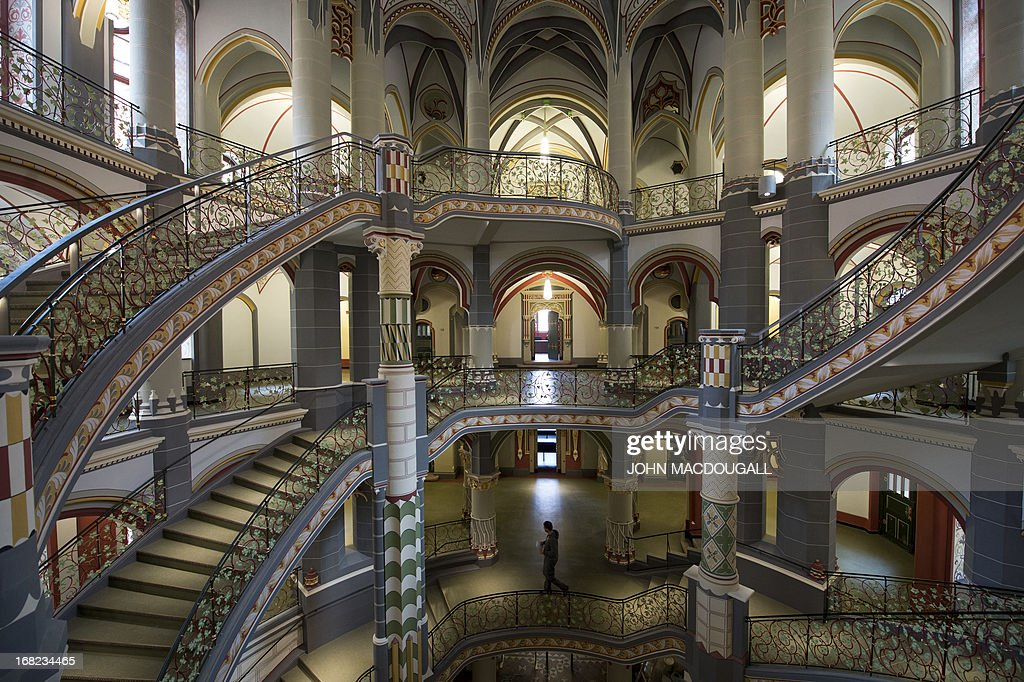 View of the the the main stairwell in the newly restored regional court house (Landgericht) in Halle, eastern Germany, on May 6, 2013. The neo-Baroque building, which combines Gothic, Renaissance and Art Nouveau styles, was completed in 1905. The building's 20 courtrooms, 110 offices were painstakingly renovated over a two-year period, and will officially reopen for business in May 2013.