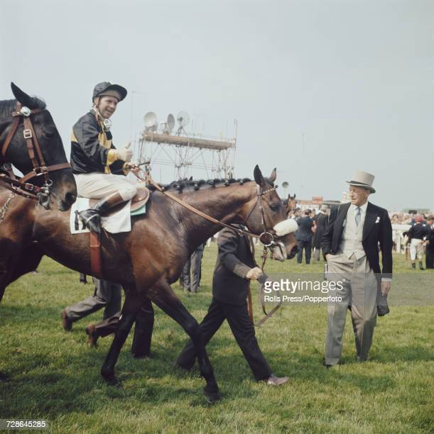 View of the thoroughbred racehorse Mill Reef trained by Ian Balding ridden by jockey Geoff Lewis being led in after finishing in first place to win...