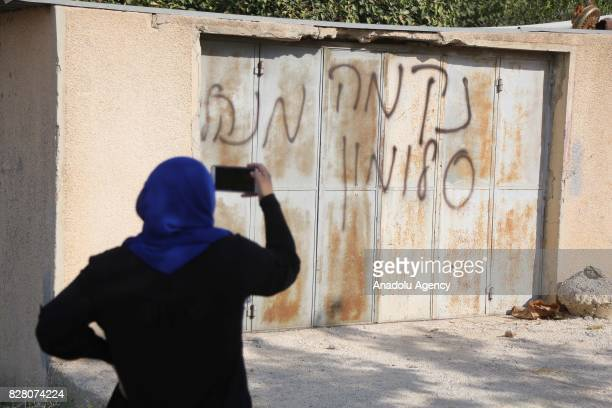 A view of the threat scrawl on a door of a house belongs to Palestinians after 3 vehicles belonging to Palestinians set on fire by Israeli settlers...
