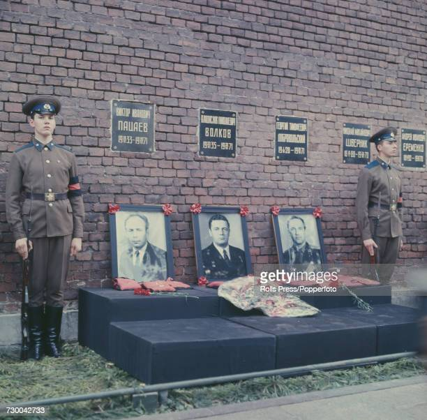View of the three graves of Soviet cosmonauts Vladislav Volkov Georgy Dobrovolsky and Viktor Patsayev with Red Army guard of honour pictured with...